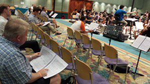 Houston Symphony principal trumpet Mark Hughes follows the rehearsal with the other faculty members.